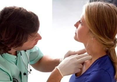 ENT doctor examining lymph nodes