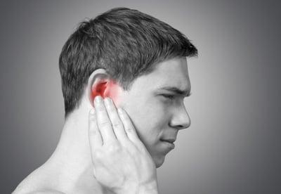 boy suffering from ear pain