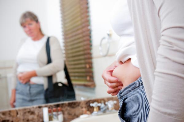 woman pinching belly fat