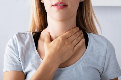 woman touching neck